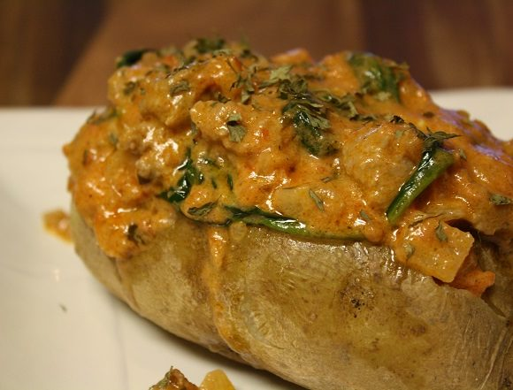 Baked Potatoes with Sausage and Spinach Sauce