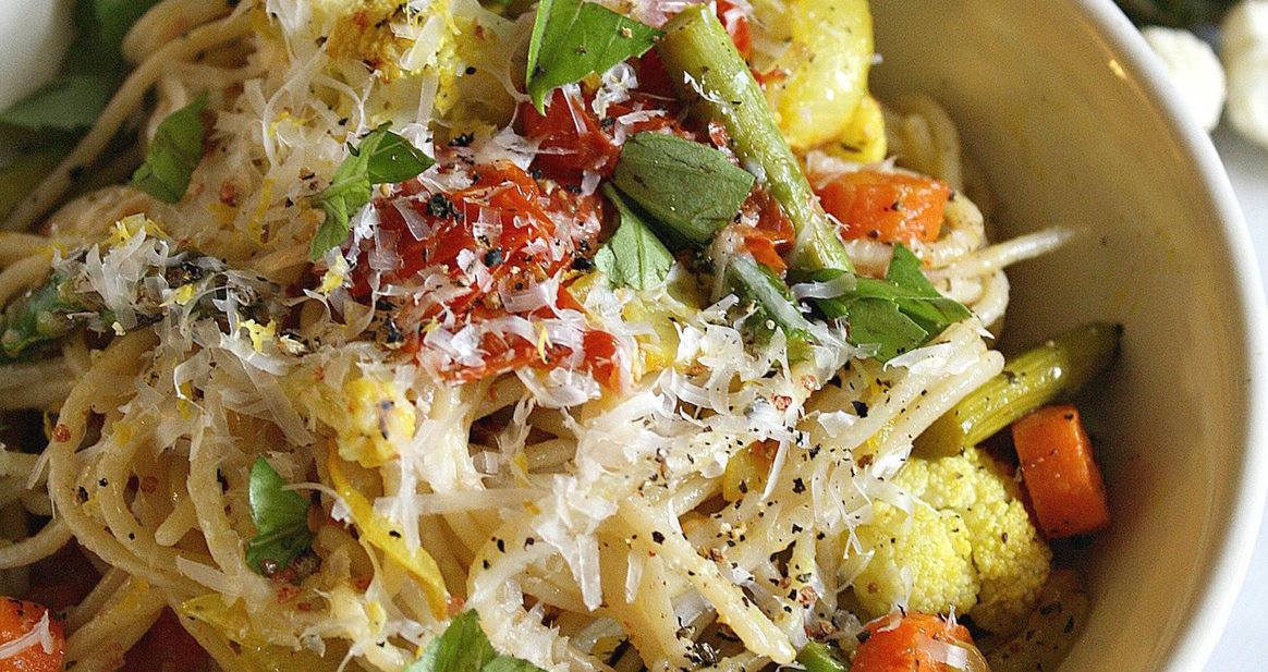 Bowl of Winter Pasta filled with gluten free noodles, cauliflower, asparagus, carrots and basil