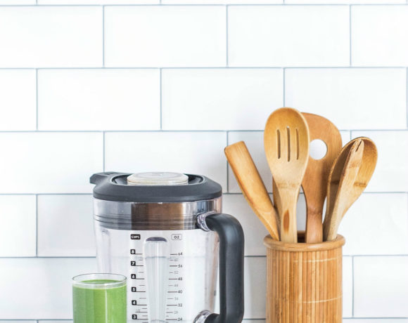 Counter with blender, utensils, and green smoothie