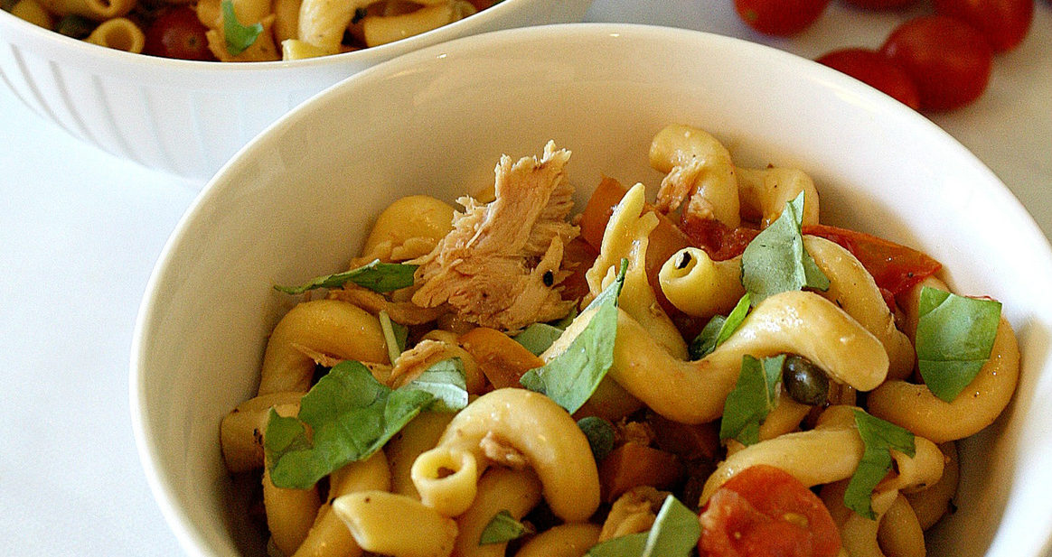 White bowls with gluten free pasta, Summer veggies, tuna, basil