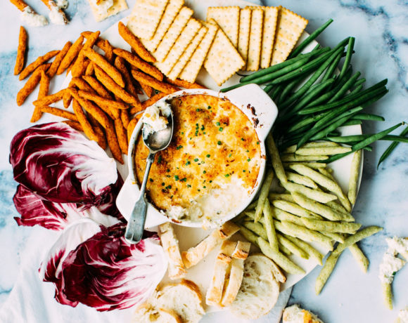 Marble with dip, vegetables, and crackers